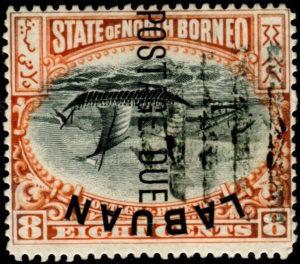 """Labuan 1901, tzv. """"Inverted Ship"""", přetiskové vydání na známce Severní Borneo 8C s převráceným středem; existuje jen několik kusů, významná rarita britských kolonií"""